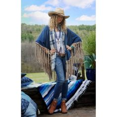 "Spring has sprung with this super chic and western denim San Angelo Shawl from Tasha Polizzi!! Forget your heavy and boxy denim jackets and add some sass to your Spring wardrobe with this piece! Featuring a medium wash denim body accented with light faux suede fringe! One size fits most with the length across the shoulder measuring approx. 43""."