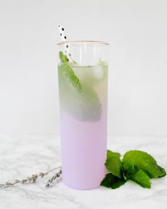 Lavender-Lemon Collins Cocktail Recipe with Gin, Royal-Rose Lavender-Lemon Syrup, Mint, and Soda Water / Oh So Beautiful Paper