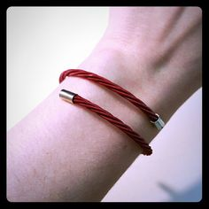 NWOT wraparound guitar string bracelet This red wraparound bracelet is made from guitar strings! Wear Your Muic is a company that designs jewelry out of musician's donated guitar strings.  This item is new without tags -- I got it as a gift and haven't worn it.  Smoke free home. Wear Your Music Jewelry Bracelets