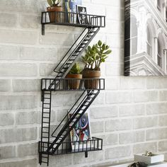 Fire Escape Back Ladder Wall Decor Shelf so Modern and Urban.  Made with hand-welded epoxy coated steel. Great for living room, kitchen or bathroom.