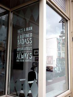 In the barbershop window.