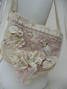 Like this idea for making a bag or for embellishing a plain or old bag - add lace, trims and handmade flowers.