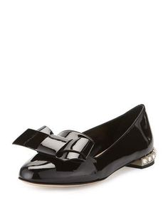 """Miu Miu patent leather skimmer flat. 0.8"""" crystal-embellished heel. Almond toe. Notched vamp with bow detail. Topstitched collar. Leather outsole. Made in Italy."""