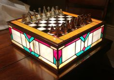 This is the stained glass chess set made by Redditor and game designer KnowNothing_JonSnoo's father (who's a stained glass artist) and given to him as a birthday present.