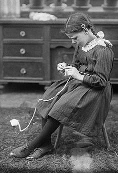 Little girl knitting.