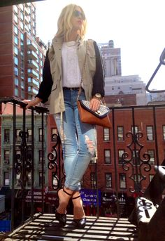 Loving this two-tone cargo jacket and embroidered white top paired with distressed denim. A perfect choice for a city getaway!