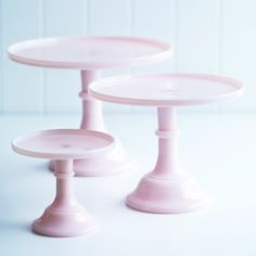 """Give your cakes and sweets the entrance they deserve with these elegant milk glass cake stands. They make the perfect pedestal for pretty treats. Also available in white and green. The diameters are: small 15.2cm (6""""); large 25.4cm (10""""); x-large 30.5cm (12"""") from $ 40"""