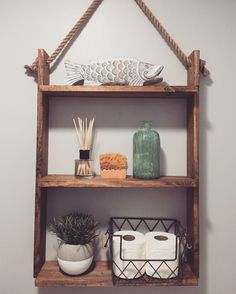 DIY hanging ladder shelf. SUPER EASY. 1x4x8 1X6x8 1 inch rope from craft store Desired wood stain