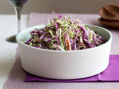Shaved Cabbage and Brussels Sprout Salad from FoodNetwork.com (like a slaw; with red cabbage, chives, apple, buttermilk)
