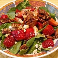Strawberry blue cheese salad. This is my favorite summer salad, very EASY to make and it's sooo Good!  http://www.yummly.com/recipe/Strawberry-Blue-Cheese-Salad-Allrecipes