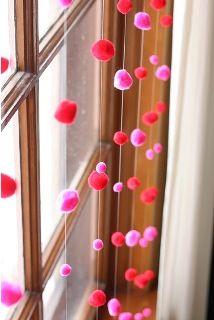 Windows with miniature pom pom garland :) cute idea