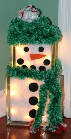 Snowman lighted blocks.  Handmade crotched scarf and hat.