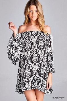 Print tunic dress featuring on-off shoulders