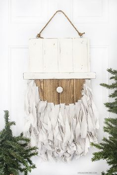 Add this Rustic Santa Door Hanger to your holiday decor -- it's simple to make and such a fun addition to your home or front door! livelaughrowe.com #DIHWorkshop #ad