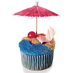 """Ultimate Beach Cupcakes - Thinking this is the design for the water carnival cupcakes for next week, except I'm skipping the blue sugar because i think it looks nasty.  Will probably just dye all the frosting blue then cover up half with """"sand"""".  Ordered gumballs, umbrellas, and fruit stripe gum.  (Who knew they still made it???)  Also putting gummy bears on the """"chairs"""""""