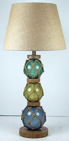 Coastal Glass Float Lamp | Ocean Styles.  I love the colors of the glass, would go perfect in my living room.  Now to convince my wife to buy them.