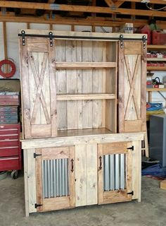 """Rustic 2 piece hutch with sliding barn doors on top and bottom tin door inserts. 2 tone stained Weathered Oak and Golden Oak. Created by """"The Trunk Trader"""", Dewey, AZ"""