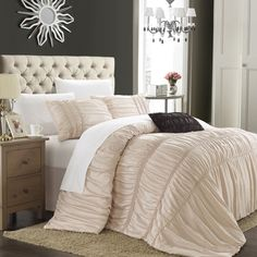 Dress up your bed with the Romano Taupe 5-piece Comforter Set from Chic Home. Featuring a taupe textured pattern, this microfiber and polyester bedding set will provide a comfortable bed to snuggle up