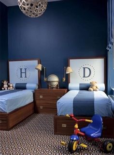 2 boys in a room. Fantastic boys' bedroom with David Trubridge - Coral 400 Pendant Lamp, blue walls paint color, twin wood monogram beds, brown & Blue David Hicks Colony Rug and blue bedding. Room, Shared Bedroom, Home, Monogram Bedding, Kids Bunk Beds, Bedroom Design, Blue Painted Walls, Boys Bedrooms, Trendy Bedroom
