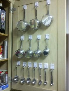 Measuring cups and spoons on cabinet door.
