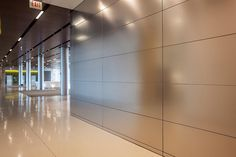 LEVELe Wall Cladding System with Float panels and custom panels in Stainless Steel with Linen finish at The Center for Care and Discovery, University of Chicago Medicine, Chicago, Illinois