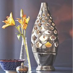 Cutout Moon Candle Holder  from Midnight Velvet. Two-piece chrome plated ceramic uses LED candles only.
