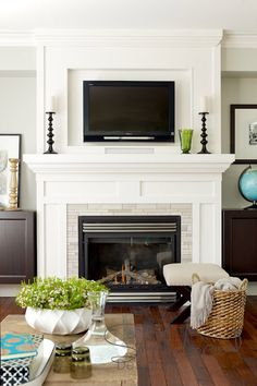 TV above fireplace - really like the moulding around and above.