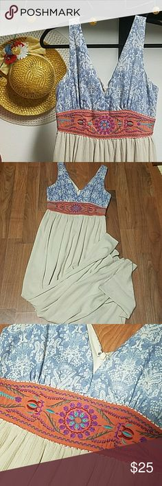Beautiful Maxi Dress Beautiful Maxi dress by Flying Tomato.  Size XS V neck and back line  Back zip closure Gorgeous embroidered waist line  The mix of colors makes this dress absolutely stunning. Gently used. No damage. Flying Tomato Dresses Maxi