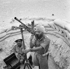 Indian troops manning a Bren light machine gun in an anti-aircraft mount in 1941.