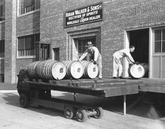 Hiram Walker & Sons employees load barrels of whiskey, October 8, 1934