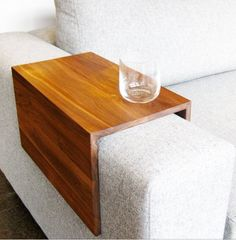 Wooden armrest table in lieu of end tables.