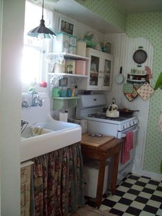 Love this retro tiny kitchen with checkerboard floor gas range and all the retro details Tiny backyard garden cottage Photos by Robin Lake Small Cottage Kitchen, Cottage Kitchens, Cozy Kitchen, Country Kitchen, Home Kitchens, Kitchen Decor, Kitchen Sink, Tiny Kitchens, Modern Kitchens