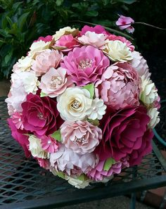 This listing for a single CUSTOM designed Bridal Bouquet, diameter measurements varying based on final design. For custom bridal package quotes contact us at mptsflowers@gmail.com or inquire through www.morepaperthanshoes.com  The flowers are made with smooth, heavy cardstock that is acid free. **Please contact us for our color chart**  All bouquets are made specifically for the purchaser, with color choices, minute details, etc tweaked to the purchasers selection. We do take certain…