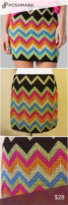 """NWT Francesca's Chevron Bandage Skirt Blue Rain L NWT Francesca's Chevron Bandage Skirt by Blue Rain --- new with tags --- size large --- black bandage skirt with five different thread shades weaved in a chevron pattern --- 90% polyester 10% spandex --- thick bandage style stretch fabric --- 15"""" waist (unstretched) --- 15"""" length --- thank you for visiting my boutique ☀️ Francesca's Collections Skirts"""
