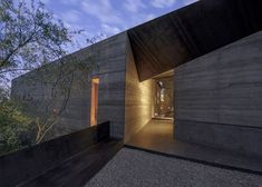 House featuring rammed earth walls and a protective weathered steel shell.