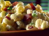 Peas and Pasta Salad - I had this at Ilona & Fred's anniversary party - it was the best pasta salad I think I'd ever had.  Leslie added tomatoes and used cubed cheese instead of shredded.