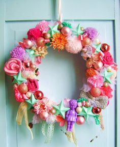 fun toy & pretties wreath (lots of yarn-made items included - bows, poms)
