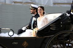 Prince Carl Philip Photos - Prince Carl Philip of Sweden and his wife Princess Sofia of Sweden ride in the wedding cortege after their marriage ceremony on June 13, 2015 in Stockholm, Sweden. - Departures & Cortege: Wedding of Prince Carl Philip and Princess Sofia of Sweden