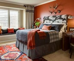 One Kings Lane - Santa Fe Style I'm not a fan of dark paint but this burnt orange with the rug and blue tones to the bedding inspire me to look at darker colors a little closer.: