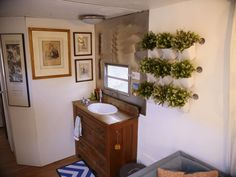 Vintage Trailer turned jewel box for sale on the Tiny House Marketplace. Fully renovated vintage Holiday Rambler for sale. Beautiful modern interior with Boxes For Sale, Jewel Box, Modern Interior, Vanity Sink, Vintage Holiday, Holiday Rambler, Birch Floors, House Interior, Tiny Houses For Sale