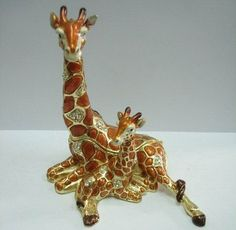 "Resting Giraffe and Baby Figurine BOX Swarovski Crystals 24K Gold Mother and Child Jewelry Box, Trinket or Pill Box by PSDZ. $42.95. This exquisite Giraffe ""Mother and Child"" figurine is also a box!  Opens to reveal a secret compartment that's completely finished in an iridescent, swirled enamel.. Set with sparkling Swarovski Crystals and meticulously hand enameled by skilled artisans.. Stocked on site! Quick Delivery! (See this item's detailed specifications below...."
