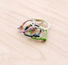 Leather stacking rings, $10.00 (for one) $28.00 (for four) on Etsy // Mint, lilac, neon green, dark green