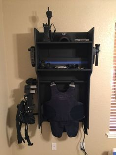 Great idea for a duty gear rack. Would like to find the person who originally shared it. Im guessing 24 wide X 36 tall X 12 deep. Customize to the person who you are building it for Cop Wife, Police Wife Life, Police Family, Police Girlfriend, Kids Police, Police Gear, Police Officer Gifts, Ms Officer, Police Shirts