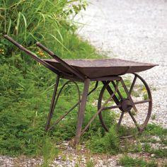 #Distressed wheelbarrow.