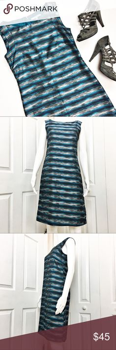 """Antonio Melani Sheath Dress Perfect work attire dress.  Features a boatneck collar, Sheath style and pull over styling with back zip and eye hook closure.  Has an all over Zebra like print in hues of black, blue, and gray.  Excellent condition. Material tag has been listed.   Measurements laid flat: Bust:  17"""" Waist:  16"""" Hip:  18.5"""" Length from top of shoulder to hem:  37"""" *Measurements are approximate. ANTONIO MELANI Dresses"""