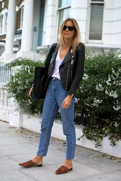 Relaxed straight-leg jeans, a white t-shirt, black leather jacket and...flat mules! Come see why we're loving this comfortable shoe trend