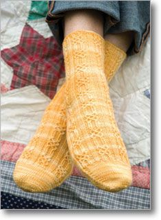 The designer uses a simple, seamless toe-up cast-on and a delicate, filigree-like Bavarian twisted stitch pattern in these socks. A firmly twisted wool sock yarn, gently variegated in cream and yellow, lets the twisted stitches pop and adds visual inte Magic Loop Knitting, Loom Knitting, Knitting Socks, Hand Knitting, Knitting Patterns, Knitting Daily, Knitting Ideas, Patricia Field, Crochet Socks