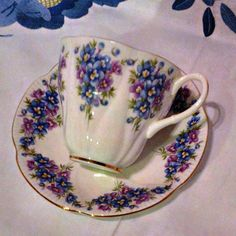 Beautiful bone china tea cup and saucer made by Royal Albert in England. This one is from the Dainty Dina series and is called Emily. The set