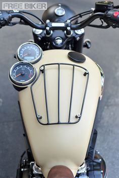 Triumph* tank with instrument cluster and luggage rack built into it