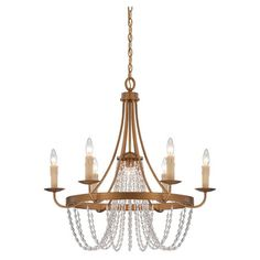 Vintaged brass chandelier with cascading crystal accents. Designed by Brian Thomas.   Product: ChandelierConstruction...